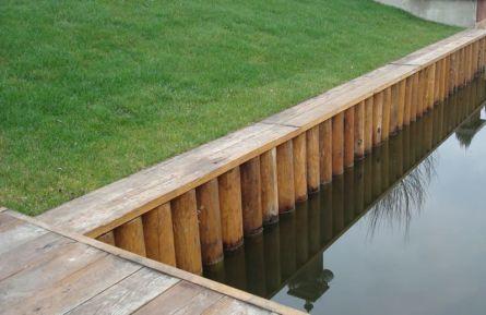 Укрепление водоема деревянным брусом 2