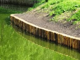 Укрепление водоема деревянным брусом