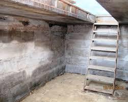 Фото входа в подвал под гаражом со смотровой ямой