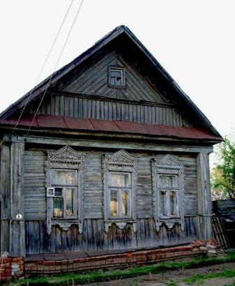 Обшивка фасада старого дома